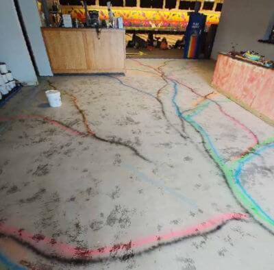 Before epoxy rainbow flooring